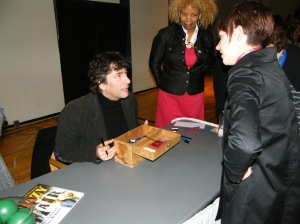 Neil Gaiman with a Coraline Box