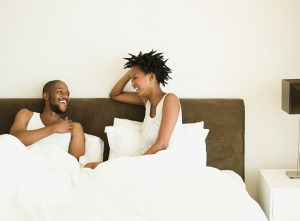 aa-couple-talking-in-bed