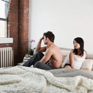 couple-in-bed-not-talking-to-eachother-article