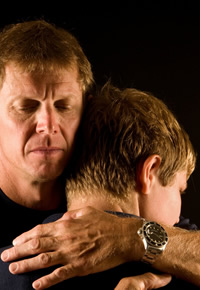 concerned-father-hugging-teen-son