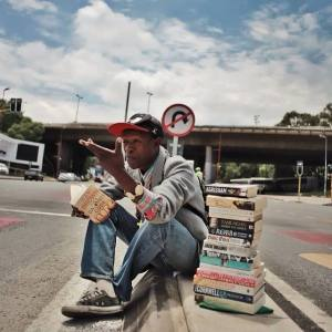 This homeless man reviews books and sells them on the street
